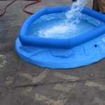 Half inflated Aqua-sac® inflation tank being filled with water