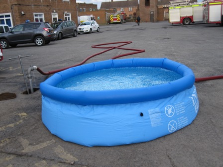 Inflation tank fully inflated and filled primed to activate Aqua-Sac®
