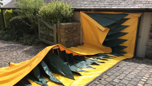 Mobile flood barrier over the driveway to stop the flood